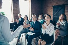 Crowd of nice cheerful trendy elegant specialists experts attending classes courses listening to coacher speaker economy stock photo