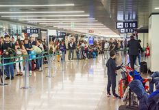 Crowd Of People Waiting In Line To Check In At An Airport Royalty Free Stock Image