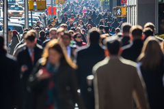 Crowd Of People Walking On Street Sidewalk Stock Image