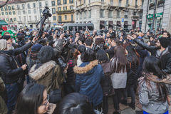 Crowd outside Gucci fashion show building for Milan Men's Fashion Week 2015 Stock Photo