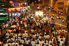 Crowd parading at Wesak Procession at Kuala Lumpur. Thousand Buddhist believers join the Wesak Day procession in front Petaling Street, Kuala Lumpur, Malaysia on royalty free stock images