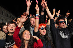 Crowd of partying people during a concert Stock Image