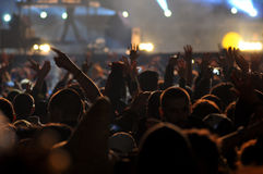 Crowd of partying people at a live concert Royalty Free Stock Photography