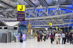 Crowd of passengers passing through the departures area of Suvarnabhumi Airport's main terminal Royalty Free Stock Images