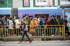 Crowd of passengers are waiting for tram Stock Photo