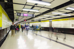 Crowd of passengers walk in Tsim Sha Tsui station on 7 Dec 2015. MTR is the main subway and train system in Hong Kong. Royalty Free Stock Photography