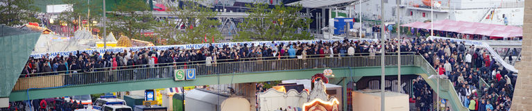 Crowd of people at the access to the harbour birth Royalty Free Stock Image
