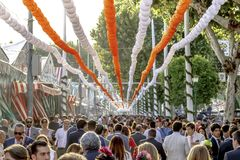 Crowd of people of all ages having fun and taking a walk at the Seville`s April Fair. Seville, Spain - May 03, 2017: Crowd of people of all ages having fun and royalty free stock image