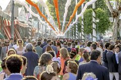 Crowd of people of all ages having fun and taking a walk at the Seville`s April Fair. Seville, Spain - May 03, 2017: Crowd of people of all ages having fun and royalty free stock photos