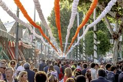 Crowd of people of all ages having fun and taking a walk at the Seville`s April Fair. Seville, Spain - May 03, 2017: Crowd of people of all ages having fun and royalty free stock photo