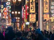 Crowd People around Kansai in Osaka,Japan. Osaka, Japan - February 2 , 2015 : Urban scene at night   with crowd people around Kansai area  in Osaka , Japan Royalty Free Stock Photography
