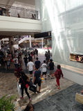 Crowd of People around mall by Louis Vuitton Fashion House. HONOLULU, HI - NOVEMBER 26: Crowd of People around mall by Louis Vuitton Fashion House on Black royalty free stock photos
