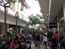 Crowd of People around mall near Forever 21 on Black Friday. HONOLULU, HI - NOVEMBER 26: Crowd of People around mall near Forever 21 on Black Friday at the Ala stock images