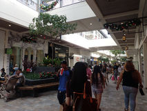 Crowd of People around mall near Kate Spade and Ted Baker. HONOLULU, HI - NOVEMBER 26: Crowd of People around mall near Kate Spade and Ted Baker on Black Friday royalty free stock image