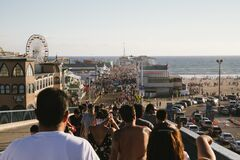 Crowd of People at Beach Carnival Stock Image