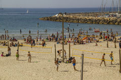 Crowd of people  on the beach of Tel Aviv in hot April day Royalty Free Stock Photo
