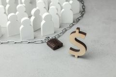 Crowd of people behind the chain with lock and dollar money symbol. The concept of financial constraints royalty free stock photography
