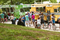 Crowd Of People Buy Meals From Atlanta Food Trucks stock images