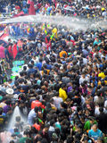 Crowd of people celebrating the traditional Songkran New Year Festival Royalty Free Stock Images