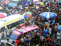 Crowd of people celebrating the traditional Songkran New Year Festival. BANGKOK - APRIL 13: Crowd of people celebrating the traditional Songkran New Year royalty free stock photos