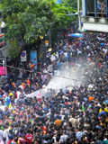 Crowd of people celebrating the traditional Songkran New Year Festival. BANGKOK - APRIL 13: Crowd of people celebrating the traditional Songkran New Year royalty free stock photography
