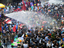 Crowd of people celebrating the traditional Songkran New Year Festival. BANGKOK - APRIL 13: Crowd of people celebrating the traditional Songkran New Year stock photo