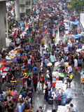 Crowd of people celebrating the traditional Songkran New Year Festival. BANGKOK - APRIL 13: Crowd of people celebrating the traditional Songkran New Year stock photography