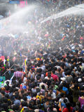 Crowd of people celebrating the traditional Songkran New Year Festival. BANGKOK - APRIL 13: Crowd of people celebrating the traditional Songkran New Year royalty free stock photo