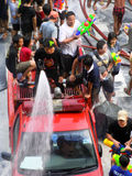 Crowd of people celebrating the traditional Songkran New Year Festival. BANGKOK - APRIL 13: Crowd of people celebrating the traditional Songkran New Year stock image