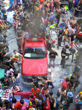 Crowd of people celebrating the traditional Songkran New Year Festival. BANGKOK - APRIL 13: Crowd of people celebrating the traditional Songkran New Year stock images