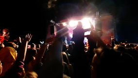 crowd of people cheering with hands in the air at concert in music festival stock video