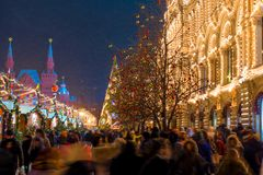 A crowd of people at a Christmas market on Red Square. In Moscow in a blizzard, evening photography Royalty Free Stock Images