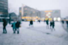 Crowd of people in city in winter. Intentional out of focus blur for anonymity stock photo