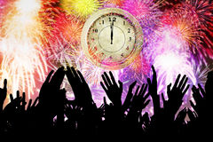 Crowd people with clock and fireworks Stock Photos