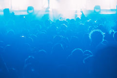 Crowd of people at the concert. Horizontal  blue background Stock Photo