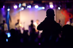 Crowd of people at concert. Crowd of people who are at a concert, a man photographs scene Stock Photography