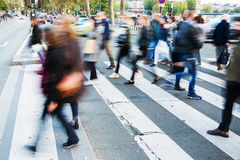 Crowd of people crossing a city street Stock Photography