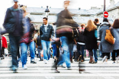 Crowd of people crossing a city street Royalty Free Stock Images