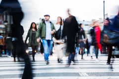 Crowd of people crossing a city street Stock Image