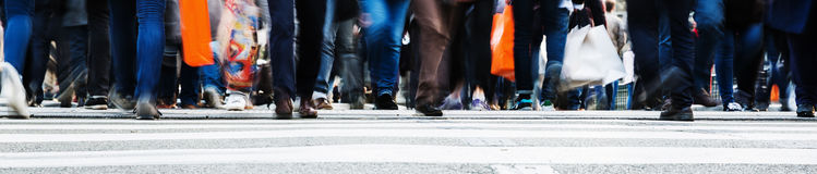 Crowd of people crossing a city street Stock Photos