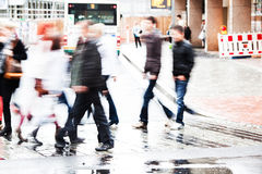 Crowd of people crossing the street Stock Photo