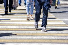 Crowd of people crossing a street in the city Royalty Free Stock Photo