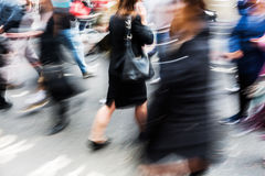 Crowd of people crossing a street in the city in motion blur Stock Photography