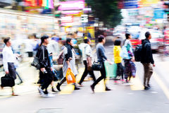 Crowd of people crossing a street in Hongkong Royalty Free Stock Images