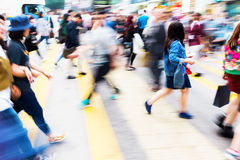 Crowd of people crossing a street in Hongkong. Picture with motion blur of a crowd of people crossing a street in Hongkong Stock Image