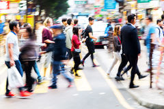 Crowd of people crossing a street in Hongkong Stock Images