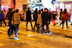 Crowd of people crossing a street at night Royalty Free Stock Photography