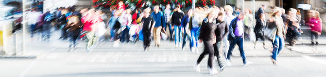 Crowd of people crossing a street with zoom effect Stock Images