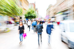 Crowd of people crossing a street with zoom effect Royalty Free Stock Image