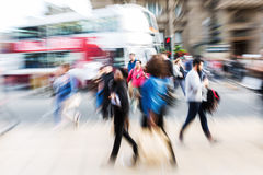 Crowd of people crossing a street with zoom effect Royalty Free Stock Photo